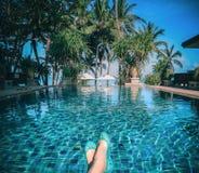 Sunbathing by the hotel tourist resort swimming poo Stock Photos