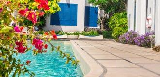 Sunbathing lounger swimming pool side. Stock Images