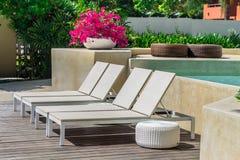 Sunbathing lounger swimming pool side. Royalty Free Stock Photo