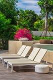 Sunbathing lounger swimming pool side. Stock Photo