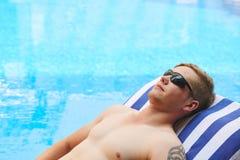 Sunbathing man Stock Images
