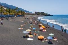 Sunbathing people at beach La Palma Island, Spain Stock Images