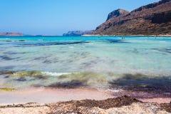Sunbathing people on gritty beach of Balos lagoone on Crete. Greece. Stock Images