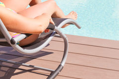 Sunbathing at the poolside Royalty Free Stock Photos