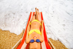 Sunbathing on the red sunbed Royalty Free Stock Photography