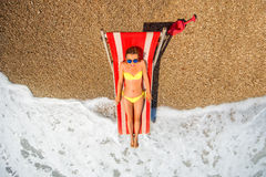 Sunbathing on the red sunbed Royalty Free Stock Images