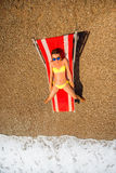 Sunbathing on the red sunbed Stock Photo
