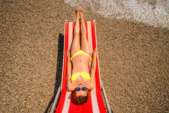 Sunbathing on the red sunbed Royalty Free Stock Image