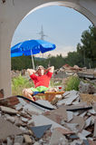 Sunbathing in the rubble Royalty Free Stock Image