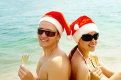 Sunbathing Santas Royalty Free Stock Images
