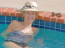 Sunbathing Senior Woman. This shot of an attractive senior woman was taken in natural sunlight Stock Photos