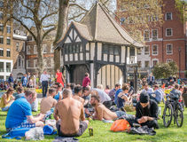 Sunbathing. At Soho Square, London, a popluar lunchtime venue for workers in the area Stock Photo