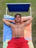 Sunbathing on sunlounger Stock Photography