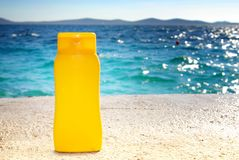 Sunbathing - suntan cream or oil on beach Royalty Free Stock Photos