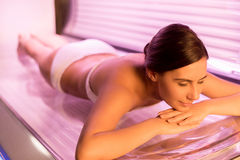 Sunbathing on tanning bed. Royalty Free Stock Photo