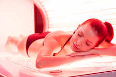 Sunbathing on tanning bed. Royalty Free Stock Image