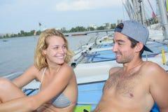 Sunbathing on top sailboat Royalty Free Stock Photo