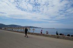 Sunbathing and walking people on Adriatic coast. Sunbathing and walking people on Adriatic beach in Bar-city, Montenegro Royalty Free Stock Photo