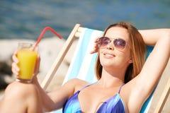 Sunbathing woman Stock Image