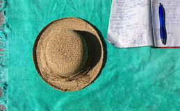 Sunbathing and working with pen and notebook outdoors Royalty Free Stock Photography