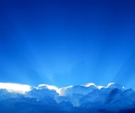 Sunbeam above the clouds Stock Image