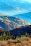 Sunbeam and autumn misty mountain. Stock Photos