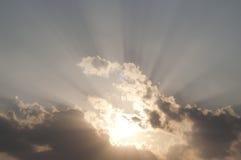 Sunbeam. Sunbeam behind cloud in sunset Stock Image