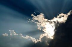 Sunbeam through the black stormy cloud. Beautiful sunbeam through the black stormy cloud royalty free stock photo