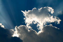 Sunbeam through the black stormy cloud Stock Images