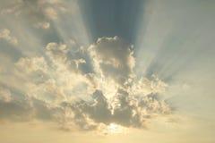 Sunbeam on blue sky stock images