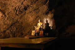 Sunbeam on Buddha statue in cave, Thailand Royalty Free Stock Image
