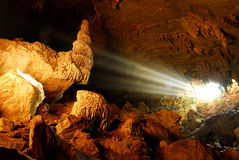 Sunbeam in cave. Sunbeam in limestone cave ,Thailand royalty free stock photo
