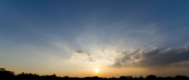 Sunbeam through cloud and sunset sky Royalty Free Stock Photography