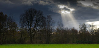 Sunbeam through clouds Royalty Free Stock Image