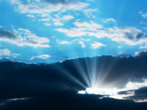 Sunbeam through the clouds Stock Image
