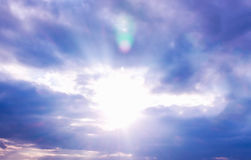 Sunbeam through clouds on blue sky. royalty free stock image