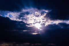 Sunbeam through clouds on blue sky. royalty free stock photography