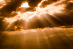 Sunbeam with clouds Stock Images