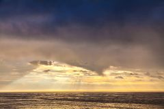 The sunbeam in evening sky and the North Sea Stock Photos