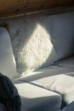 Sunbeam Falls on a White Sofa Stock Photography
