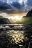 Sunbeam at a fjord. At sunset in norway stock photos