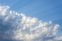 Sunbeam  through the haze on blue sky: can be used as background and dramatic look, Royalty Free Stock Photos