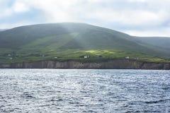 Sunbeam on irish landscape over cliffs Royalty Free Stock Photo