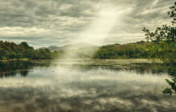 Sunbeam on lake Stock Images