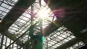 Sunbeam, light through the glass roof. Metal constructions.