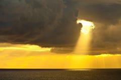 Sunbeam and ocean. Single sunbeam shining through dark clouds on the caribbean sea Royalty Free Stock Photo