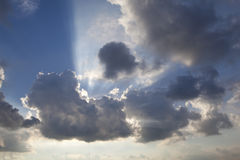 Sunbeam poking through the clouds Royalty Free Stock Photo