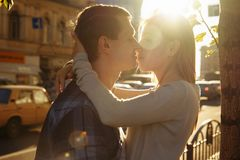 Sunbeam, the sun between the lips and the faces of a loving couple date.the sun shines on the faces, the rays of the sun. Sunbeam, rays from the sun, the sun stock photography