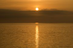 Sunbeam reflected sea. Orange view of gentle sea which a sunbeam reflected at sunrise Stock Images