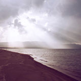 Sunbeam through the sea with retro effect. Sunbeam through the sea with retro filter effect Royalty Free Stock Images